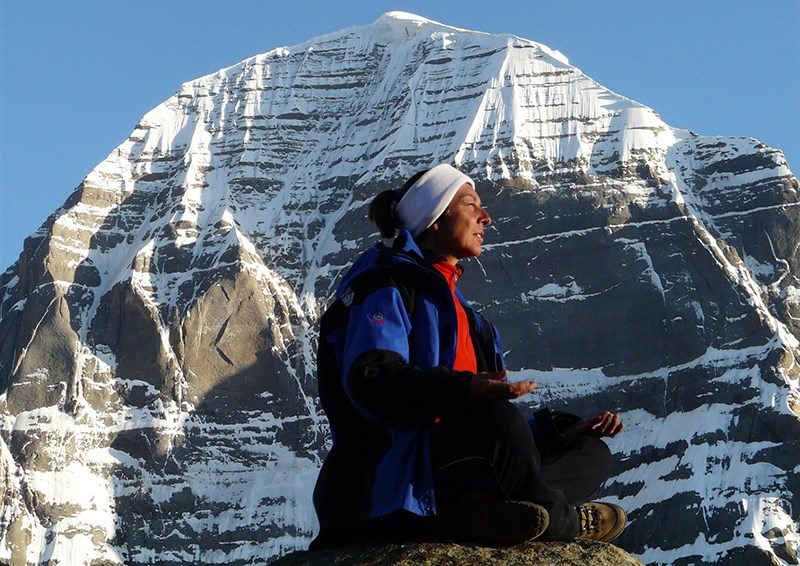 Pilgrim in front of the Holy Mountain Kailash